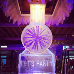 ice sculpture with Let's Party etched on bottom column