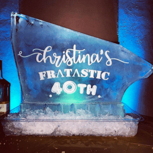 "Single Track shot block made of ice with the words ""Christina's Fratastic 40th"" etched on the side"
