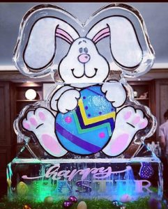 Easter Bunny shaped Ice Sculpture with colored effect by Full Spectrum Ice Sculptures