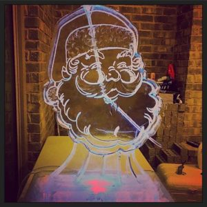 Santa Claus face ice luge by Full Spectrum Ice Sculptures