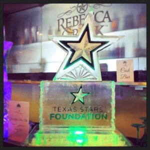Texas Stars ice sculpture with logo on pedestal by Full Spectrum Ice Sculptures
