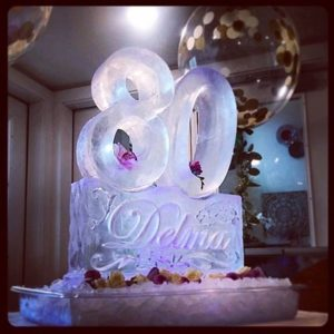 80th birthday ice sculpture on pedestal with name; by Full Spectrum Ice Sculptures, serving Austin to San Antonio