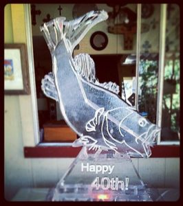 Fish shaped ice luge for themed 40th birthday party; by Full Spectrum Ice Sculptures, serving Austin to San Antonio