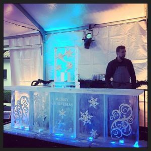 Christmas themed ice bar by Full Spectrum Ice Sculptures