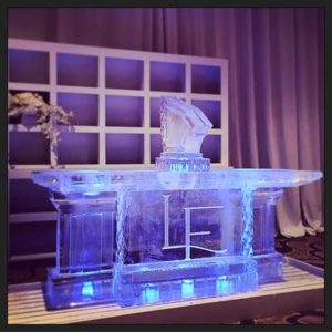 Full Ice Bar with Shot Luge and Initials etched on the front by Full Spectrum Ice Sculptures