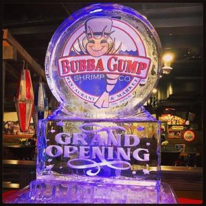 Circle on pedestal ice sculpture with Bubba Gump logo on pedestal etched with Grand Opening; by Full Spectrum Ice Sculptures; Serving Austin to San Antonio
