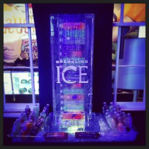 Custom Ice sculpture as drink dispenser with Sparkling Ice logo etched on the front; by Full Spectrum Ice Sculptures, Serving Austin to San Antonio