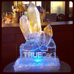 Ice Sculpture in the shape of budding crystals on pedestal etched with TRUECar logo by Full Spectrum Ice Sculptures