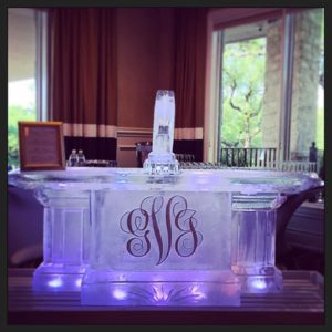 Ice Bar with monogram on the front and ice luge at center top by Full Spectrum Ice Sculptures