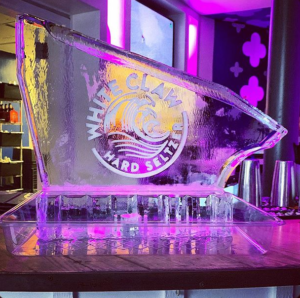 Ice Luge by Full Spectrum Ice Sculptures with White Claw logo on the side